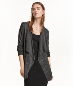 Dark gray melange. Fine-knit cardigan in a soft fabric with a draped front section. Rolled edges at front and at cuffs. No buttons.
