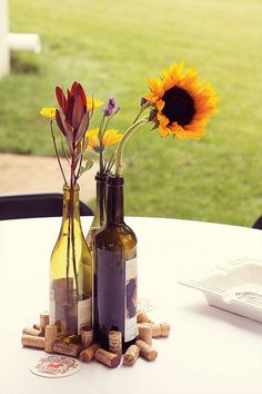 re-purposed wine bottle as flower vase for wedding centerpieces