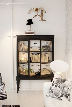 Bookshelves don't have to be boring. Learn all the ways to perk them up, like by displaying artwork, accessories, and even booze. We also love subtle touches like the quirky wall decals pictured here.