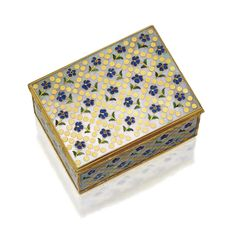 GOLD, ENAMEL AND MOTHER-OF-PEARL SNUFF BOX WITH FRENCH GOLD MOUNTS, FRENCH, MID 18TH CENTURY The rectangular box with hinged lid, the wavy chased gold cagework mounts enclosing later mother-of-pearl panels inlaid with enameled yellow-centered blue flowers sprinkled within a lattice of gold pellets, gold lined,