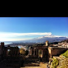 There is probably only one  place in the world where you can enjoy the view of an active volcano sitting in a Greek theatre. Taormina !