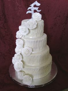 Red velvet w cream cheese frosting and hand made fondant flowers and topper by janna elsey