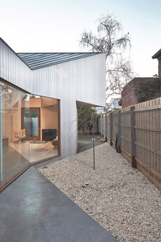 Melbourne home featuring a narrow patio along its southern boundary.