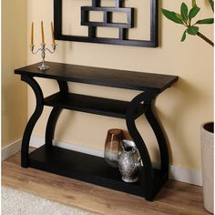 Great smooth lines of design in this functional foyer/entryway table!  Sara Black Finish Console Table | Overstock.com