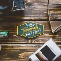 Take Heart Apparel Co. Live Generously iron-on patch - 20% from each purchase of this patch goes to the life-transforming partner charity of your choice.