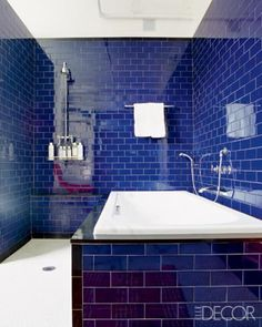 Room/Style: Bathroom, Traditional	    Notes: Architect Steven Learner drew inspiration from the indigo tiles that line traditional Turkish hammams for the open shower in his downtown Manhattan apartment. Learner sheathed his master bath in shiny subway tiles of a deep cobalt, which he offset with a pure-white tub.    Photographer: Pieter Estersohn  Designer: Steven Learner  Featured in: Irresistible Open Showers  Issue: May 2010