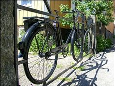 Love this wrought iron gate with bicycles. Very nice    alamodeus: Through the garden gates ...