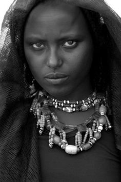 """Africa   The Afar people are also known as the Danakil, so named for the desolate desert triangle where they live, between Eritrea, Ethiopia, and Djibouti. It is a purely nomadic society, roaming the desert environs with the herds of livestock. This woman is named Fatuma.   © """"Tribes of the Great Rift Valley"""" by Elizabeth L Gilbert"""
