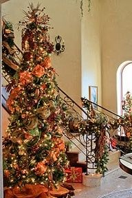 Christmas tree and stairway garland, complete with orange moire and Burgundy velvet ribbon Orange Christmas Tree, Beautiful Christmas Trees, Noel Christmas, Holiday Tree, Christmas Colors, Xmas Tree, Winter Christmas, Halloween Christmas Tree, Christmas Stairs