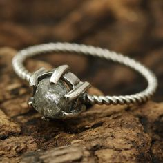 Light grey rough diamond and sterling silver ring in prongs setting with oxidized sterling silver twist design band