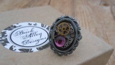 Steampunk Ring - Handmade Vintage Watch Movement - Amethyst West German Glass Cabachon - Silver Plated Adjustable - Purple Bold Finger Ring by BackAlleyDesignsINK on Etsy
