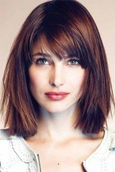 A straight, brunette bob with bangs.