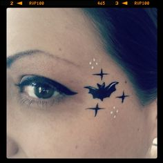 Teeny tiny bat eye design! Face painting by Glitter Goose. Paint ideas halloween vampire cute.