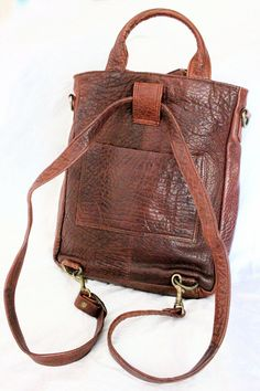 Vintage Whiskey Leather Convertable Backpack by claudedonohoshop