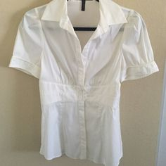 White BCBG Button Down Short sleeve white button down. There's a tie in the back! No trades. BCBGMaxAzria Tops Button Down Shirts