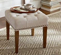 """Lorraine Tufted Stool   Pottery Barn - $249. Dimensions are 18.75"""" square, 19"""" high. Kiln-dried oak legs and Bronze nail heads."""