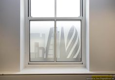 This frosted window film/manifestation is ideal for disguising unsightly views outside office windows.