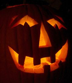 Light; Aglow: means to glow. The candle inside of the jack-o-lantern is making the face glow.