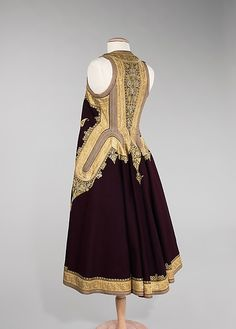 Coat.19th century, Albania. This stunning full-length, sleeveless coat was fashioned from wool, silk, metal and cotton. The intricate designs indicate heavily to the heavy Ottoman influence in the region at the time.