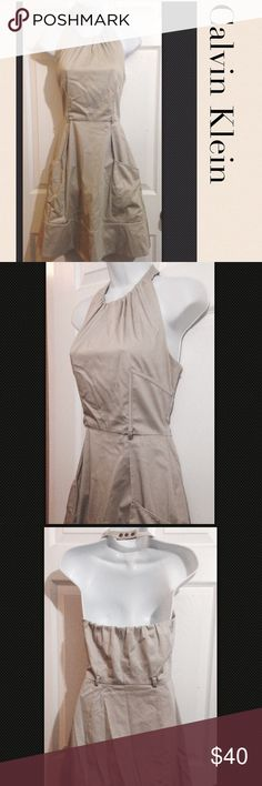 """CALVIN KLEIN Halter Dress Size 4 SMALL Size 4 see measurements as sizing and fit differ due to manufacturer, body shape and style This is a good quality dress w thin belt loops and a left side underarm zipper.  Great for career w a jacket or cardigan or wear alone w cute wedge sandals for casualKhaki Tan cotton w 3% spandex w a polyester lining in bust areaMeasurements taken laying flatU to U16""""elastic in backTop to waist 16""""Top tohem37""""Waist width 14.5"""" Hip 21""""Pre-owned in…"""