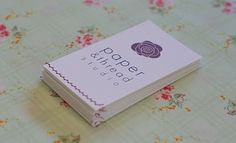 Business cards with pretty decorative stitching
