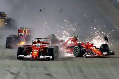 Sebastian Vettel of Germany driving the Scuderia Ferrari SF70H and Kimi Raikkonen of Finland driving the Scuderia Ferrari SF70H collide at the start...