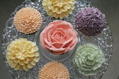 Vintage colors Floral Cupcakes...love these. Different shades of purple and white with silver accents