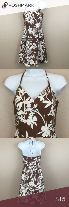 ROBIN JORDAN 4 FIT & FLARE FLORAL HALTER DRESS See my other cute item**  size 4, brown and white floral print.  Zips in back, boning in the bodice.  97% cotton, 3% spandex.  Has some stretch. Robin Jordan Dresses Midi