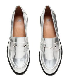 Loafers in glossy metallic imitation leather. Rubber soles. Heel height 1 1/4 in.