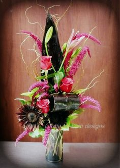 Deep red roses, amaranth's, and lilies paired with hot chocolate sunflowers and ti-leaves.  A stunning and affordable arrangement for your Valentine.