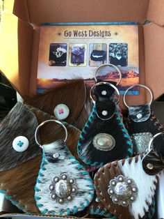 Key fobs and coin purses. Stocking stuffers from gowestdesigns.us