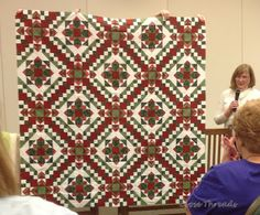 Easy Streetby Judy. (Easy Street is Bonnie Hunter's mystery quilt from 2012.) Visit Judy's blog, Small Quilts and Doll Quilts. Judy used reds and greens for her Easy Street quilt, and she has set her blocks differently than the pattern. It's just gorgeous.