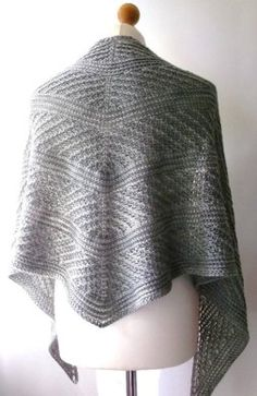 This lightweight top down shawl uses twisted stitches and braids to create a beautifully textured garment.