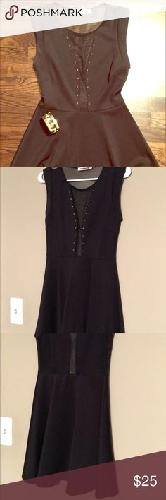 Black Skater Dress with sheer panels Sexy skater dress with peekaboo sheer panels. The center of the dress is sheer and so is the entire back panel. Ultra flattering and perfect for a night out! Dresses