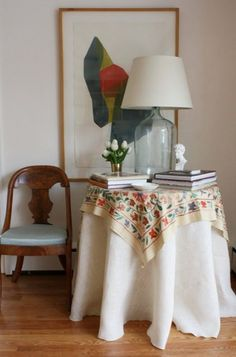 suzani, antique chair and demijohn lamp