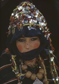 Africa | Young bride of Ait Haddidou tribe wearing capes of berber design and covered in silver ornaments. Morocco, 1972 | ©Bruno Barbey