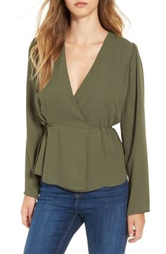Free shipping and returns on June & Hudson Long Sleeve Wrap Top at Nordstrom.com. A surplice V-neckline and loose, long sleeves add to the casual elegance of this beautifully draped top with a cinched, wrap-style waist that releases into a fluttering peplum.