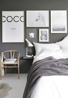 Uber modern grey & white bedroom This photo wall can easily be replicated by framing some cute posters in the same tone