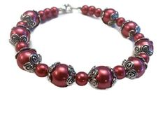 Check out this item in my Etsy shop https://www.etsy.com/listing/210040252/burgundy-glass-pearl-bracelet-bridesmaid