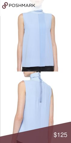 Vince blue laser cut sleeveless turtleneck top Never worn super cute blue top paired with jeans or your favorite pair of black leather pants. Vince Tops Blouses