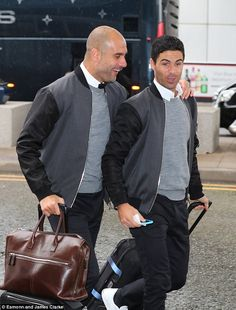 City manager Guardiola shares a joke with assistant coach Mikel Arteta as they arrive at Manchester Airport for their flight Manchester City Wallpaper, Posh Clothing, Mikel Arteta, Nylon Bomber Jacket, Manchester Airport, Barcelona Fashion, Billionaire Boys Club, Arsenal Fc, Preppy Outfits