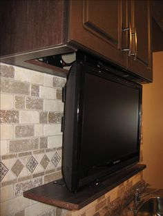 Close up of one of our Drop Down TV Lift Systems in a Kitchen Cabinet Tv Cabinets, Kitchen Cabinets, Kitchen Appliances, Drop, Furniture, Home, Restaining Kitchen Cabinets, Cooking Ware, Home Appliances