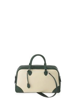 Colorblocked bowler style bag with contrast piping and paneling. Features elegant top handles as well as comfortable shoulder straps. Perfect carryall to take from day to night.100% Calf Leather.