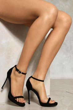 Classic. These heels feature a stiletto heel, peep toe, and ankle strap with buckle closure at side. Take advantage of its versatility and wear with any outfit you want to elevate.