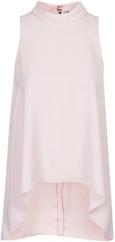Topshop Sleeveless roll neck top with dipped hem and back zip. 100% polyester. machine wash. on shopstyle.com