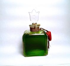 """VINTAGE RAPHAEL REPLIQUE PERFUME BOTTLE FULL AND SEALED! The bottle has never been opened and has it's original seal, but is missing it's front label. The bottle and stopper are in excellent condition with no cracks or chips. The bottom is marked """"Raphael Made In France."""" It measures 3 3/4 inches high and 2 inches wide."""