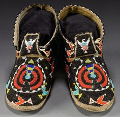 A PAIR OF CHEYENNE BEADED HIDE MOCCASINS