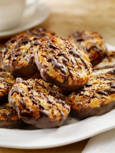 CHOCOLATE AND COCONUT, THEN BAKE A YUMMY BATCH OF THESE VEGAN MACAROONS COATED IN DARK CHOCOLATE.