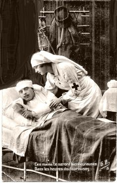 WW1 Red Cross Nurse cares for a French soldier in an overseas medical hospital.