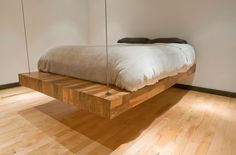 A suspended bed frame... Gosh some people are so creative!
